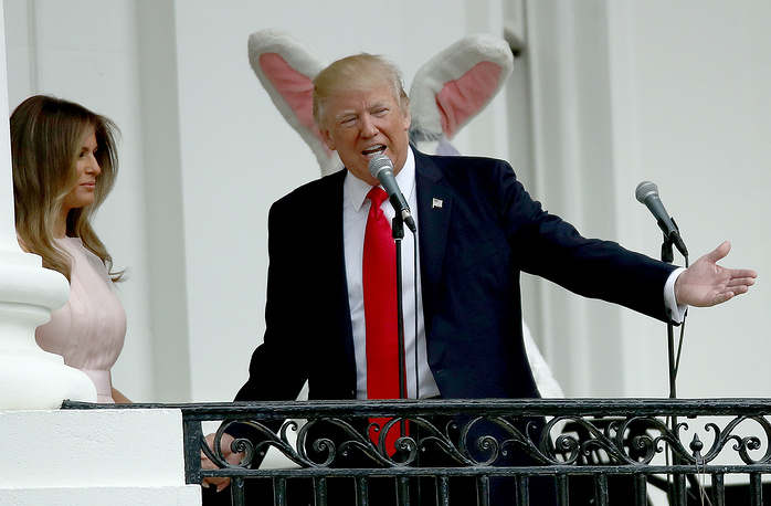 US President Donald Trump and US first lady Melania Trump welcome guests to the White House during the 139th Easter Egg Roll on the South Lawn of the White House in Washington, April 17