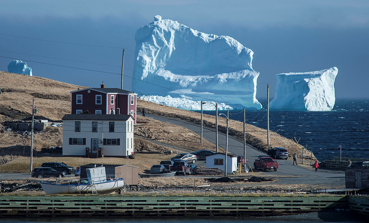 "Residents view the first iceberg of the season as it passes the South Shore, also known as ""Iceberg Alley"", near Ferryland Newfoundland, Canada, April 16"