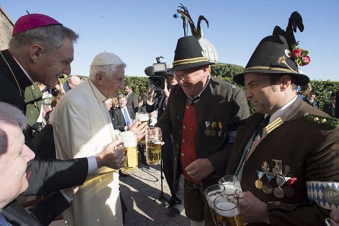 Pope Emeritus Benedict XVI meets a delegation from Bavaria on the occasion of a party for his 90th birthday, at the Vatican Monday, April 17