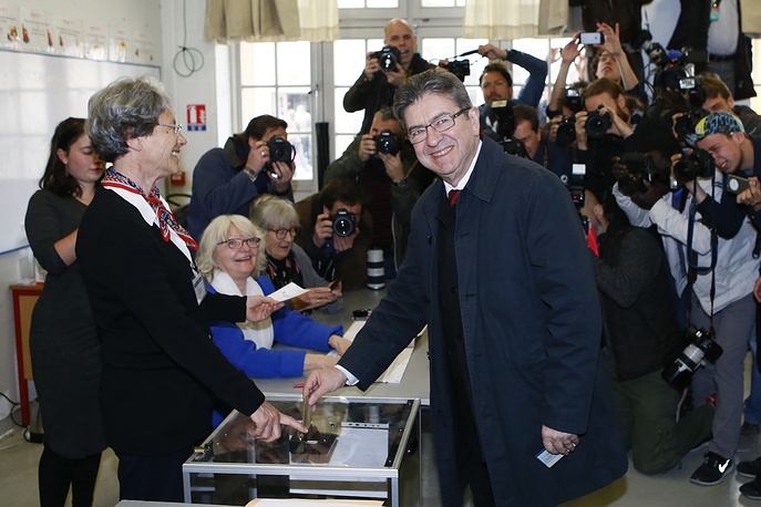 Jean-Luc Melenchon casts his ballot to vote in the first round of the French presidential election, in Paris