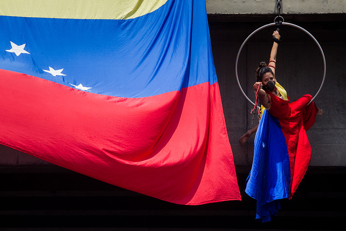 The artist Marilu Garcia performs a presentation titled 'Repressed Venezuela; during a demonstration against the Venezuelan government in Caracas, Venezuela, April 24