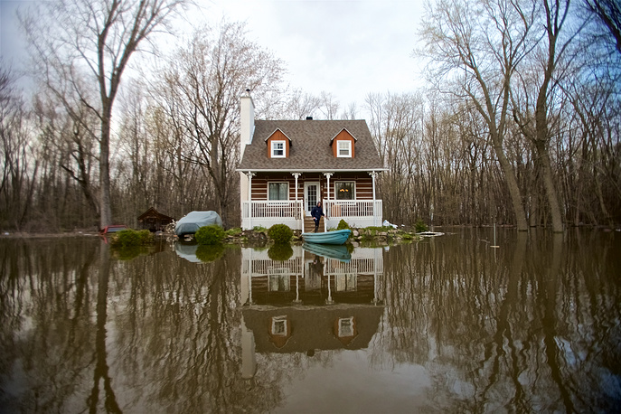 A view of a house surrounded by floodwaters in Pointe-Calumet, Quebec, Canada, May 8