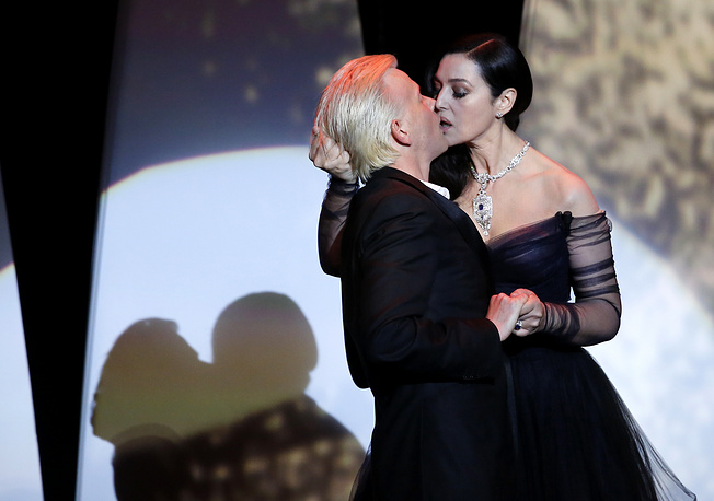 Mistress of Ceremony, Italian actress Monica Bellucci  kisses French actor Alex Lutz