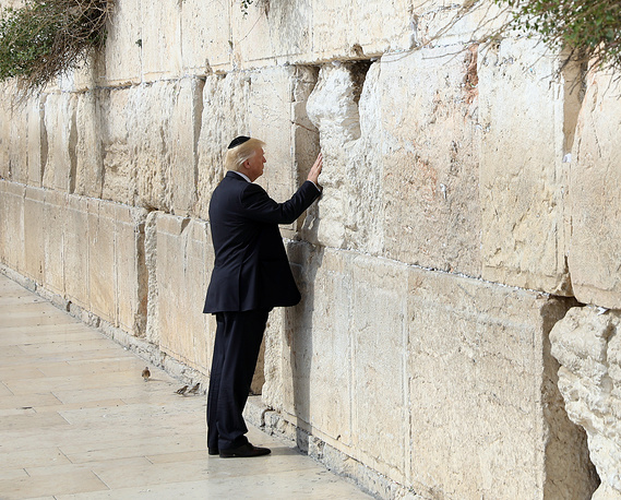 US President Donald Trump touches the Western Wall, Judaism's holiest prayer site, in Jerusalem's Old City