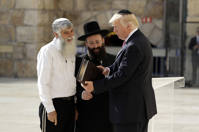 "US President Donald Trump, accompanied by Shmuel Rabinovitch, Rabbi of the Western Wall and Mordechai ""Suli"" Elias, director general of the Western Wall Heritage Foundation, visits the Western Wall in Jerusalem"