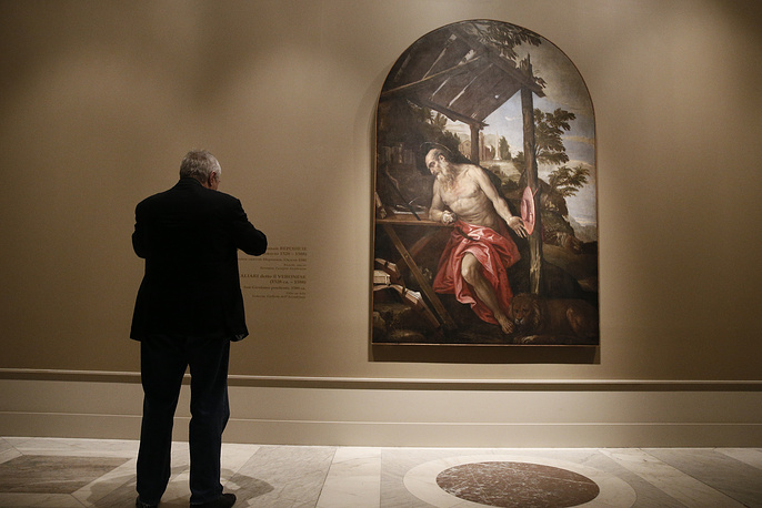 A visitor views St Jerome by Paolo Veronese dated around 1580