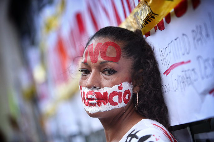 A person participates in a journalists' protest asking for justice in recent attacks on journalists in Mexico City, Mexico, June 15