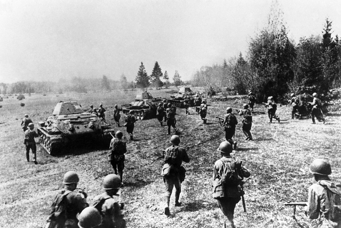 Soviet infantrymen supported by tanks attack German invaders in the Battle of Moscow on the Eastern Front of World War II, 1941