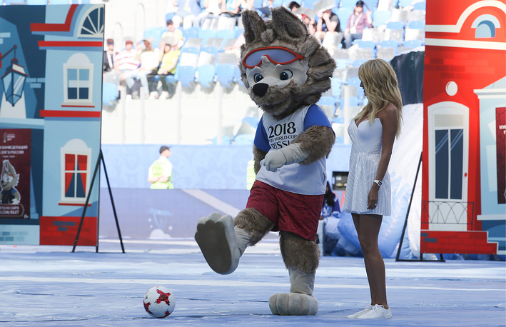 Wolf Zabivaka, the official mascot of the 2018 FIFA World Cup, and FIFA World Cup Ambassador, TV presenter Victoria Lopyreva seen at an opening ceremony of the 2017 FIFA Confederations Cup at Saint Petersburg Arena Stadium, June 17