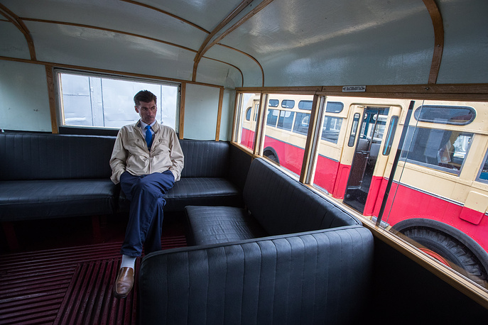 A passenger inside a vintage bus ahead of a parade marking Day of Moscow Public Transport