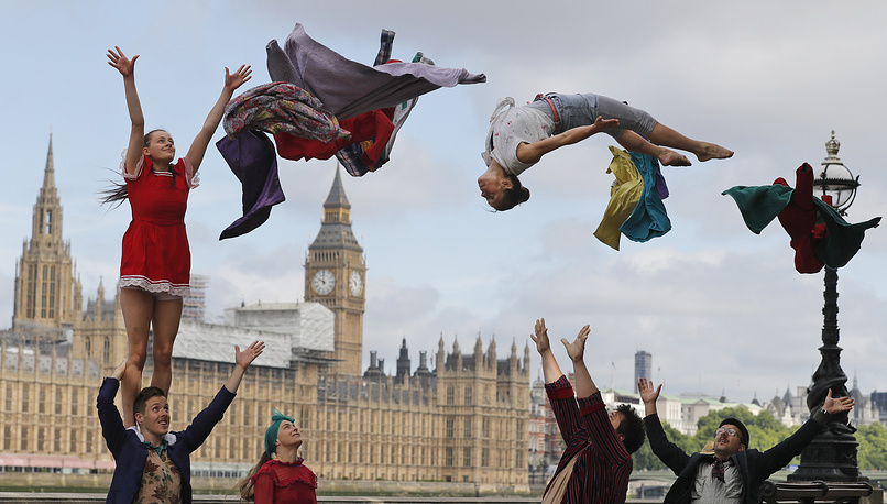 Circus artists perform a stunt opposite the Houses of Parliament to announce the official launch of Circus250 in London, UK, July 25