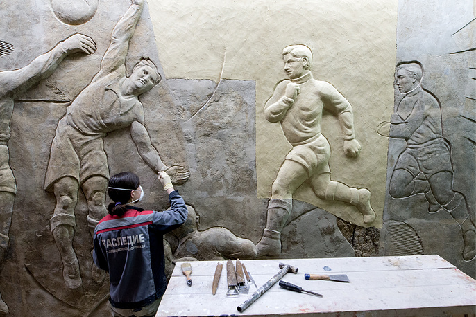 Restoring the bas-reliefs (beginning of the 1930s) by sculptor Sergei Merkurov that used to decorate the southern and northern facades of Dynamo Stadium in Moscow, Russia, August 16