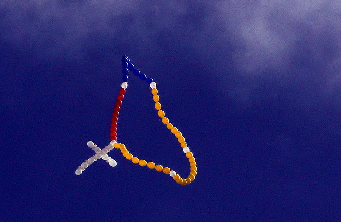 A rosary made with balloons seen during the passage of the canvas of the Virgin of Chiquinquirá towards the Cathedral Primada, in Bogota, Colombia, September 2