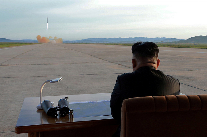 The North Korean leader Kim Jong-un watches from a distance the launch of an intermediate range missile Hwasong-12, North Korea, September 16