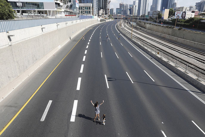 Israelis ride their bicycles on a deserted highway during the Jewish holiday of Yom Kippur in Tel Aviv, Israel, September 30