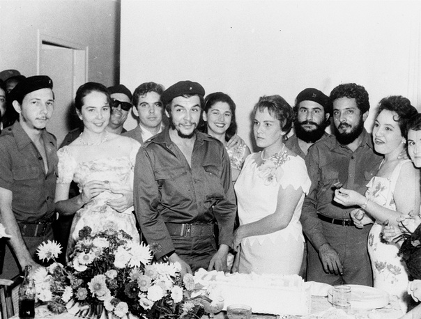 Major Ernesto Che Guevara, 34, Argentine hero of the Cuban revolution, and his bride Aleida, stand before the wedding cake following their marriage at a civil ceremony at La Cabana Military fortress, 1959