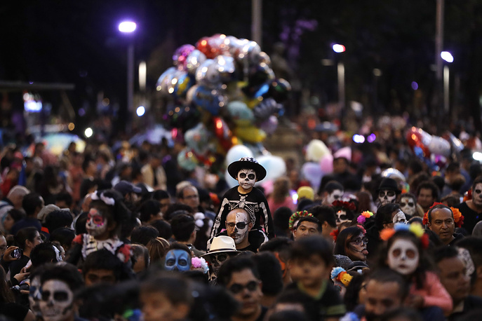 "People march in the Grand Procession of the ""Catrinas,"" part of upcoming Day of the Dead celebrations in Mexico"