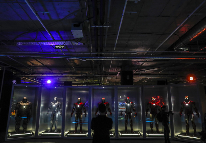 A visitor views Tony Stark's Iron Man suits