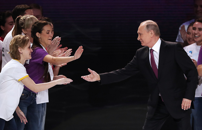 Russia's President Vladimir Putin at the 2017 Volunteer of Russia award ceremony at the Megasport Arena, December 6. Later in the day, he announced his decision to run for re-election at a meeting with veterans and workers of the GAZ automobile plant