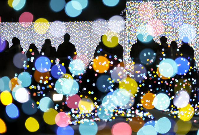 Visitors view an illumination show at an amusement park on the outskirt of Tokyo, Japan