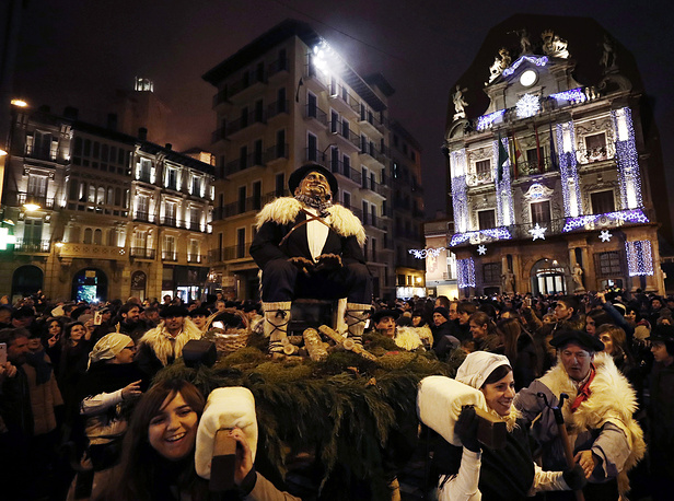 Thousands of people take part in the traditional procession of the 'Olentzero' on Christmas Eve in front of the City Council of Pamplona, Spain, December 24. The Olentzero is a legenday figure who brings presents to the homes of the Basque people on Christmas Eve