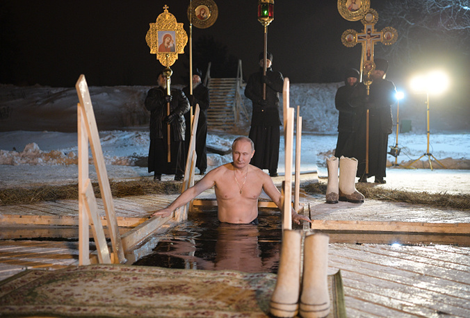 Russian President Vladimir Putin takes a dip in the frigid waters of Lake Seliger during the celebration of Epiphany, Russia, January 19