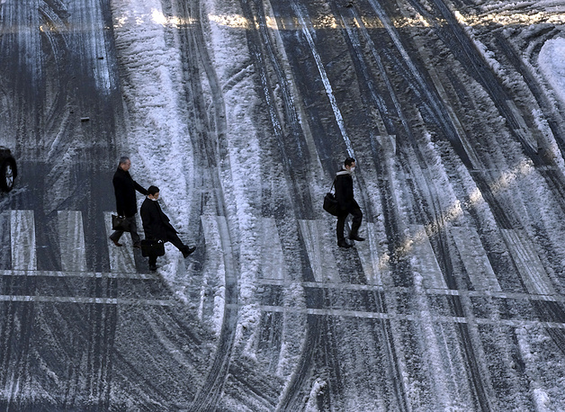 People walk on a snow-covered street in Tokyo
