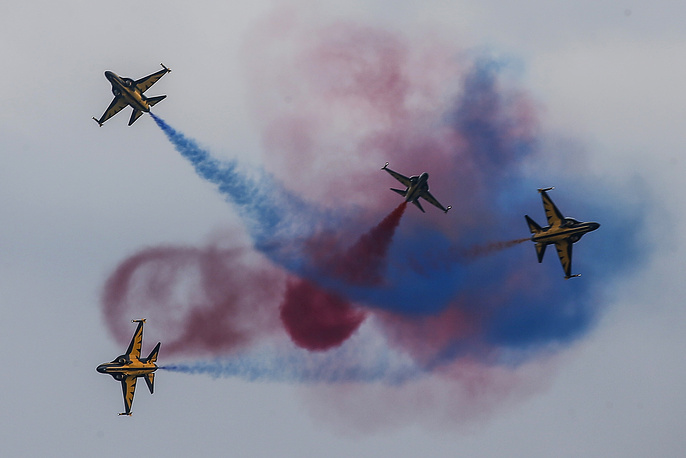Four Republic of Korea Air Force (ROKAF) T-50 jets, dubbed the 'Black Eagles', perform aerobatic maneuvers