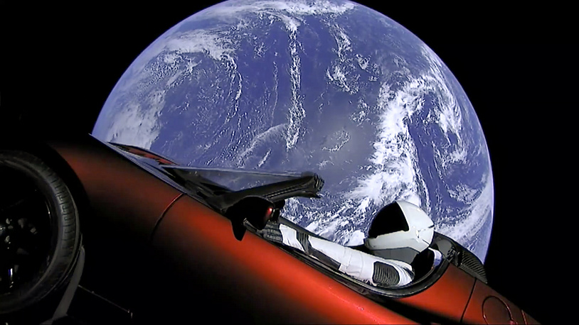 SpaceX spacesuit in Elon Musk's red Tesla sports car that was launched into space during the first test flight of the Falcon Heavy rocket, February 6