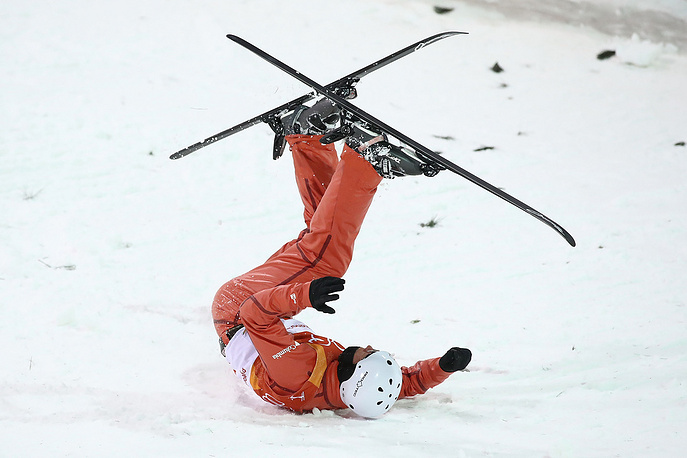 Stanislau Hladchenko of Belarus crashes during men's freestyle skiing final