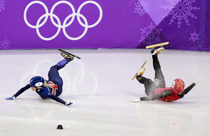 Elise Christie of Britain and Yang Zhou of China crash during women's short track speed skating 1500m semifinals
