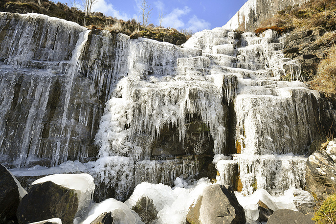 Icicles formed on a frozen waterfall near Pen y Fan mountain in Brecon Beacon National Park, Wales