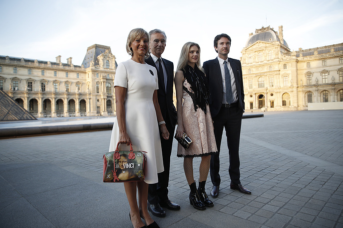 Natalia Vodianova, father of her two youngest children, Antoine Arnault, head of LVMH luxury group, Bernard Arnault with his wife, Helene Arnault