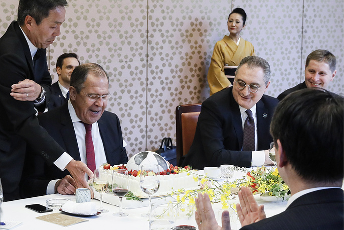 Russia's Foreign Minister Sergey Lavrov presented with a soccer ball-shaped cake by Japan's Foreign Minister Taro Kono for his birthday at the Iikura Guest House, Tokyo, Japan, March 21