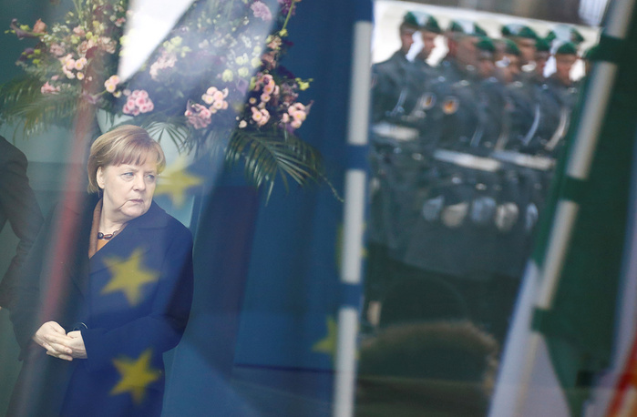German Chancellor Angela Merkel waits at the chancellery in Berlin, Germany, March 20