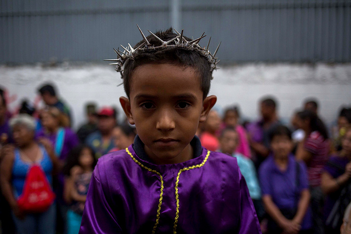 A parishioner participates in the annual Holy Wednesday procession in Caracas, Venezuela