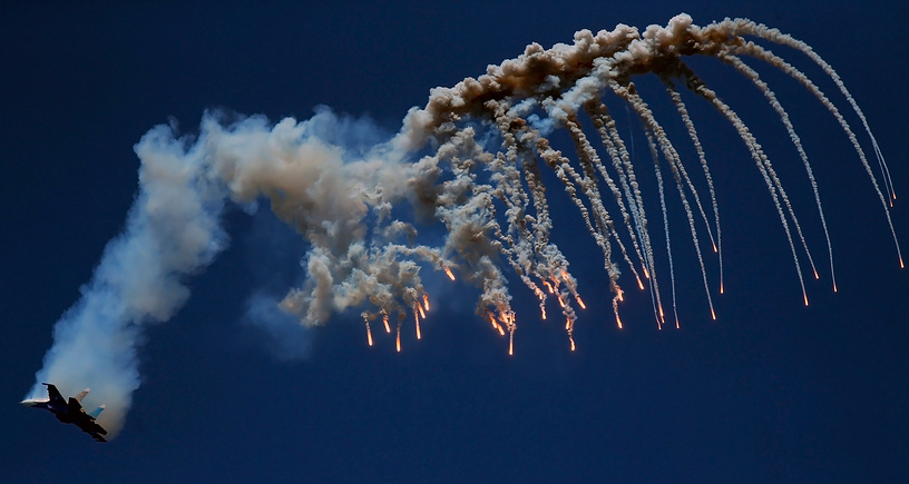 Sukhoi Su 27 fighter jets from the Russian Knights aerobatic team perform stunts over Sevastopol