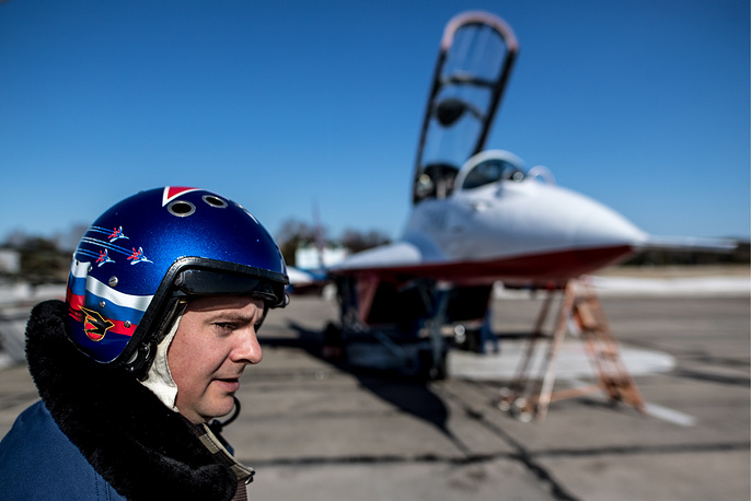 A member of the Strizhi [Swifts] aerobatic team seen before rehearsing an air show at the Kubinka air base ahead of a Victory Day military parade held in Moscow's Red Square
