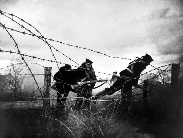 Marines of the Black Sea Fleet landing troops rush forward through a barbed wire fence on Septermber 16, 1943 in a military operation of the Soviet Navy to recapture Novorossiysk from the German forces during World War II