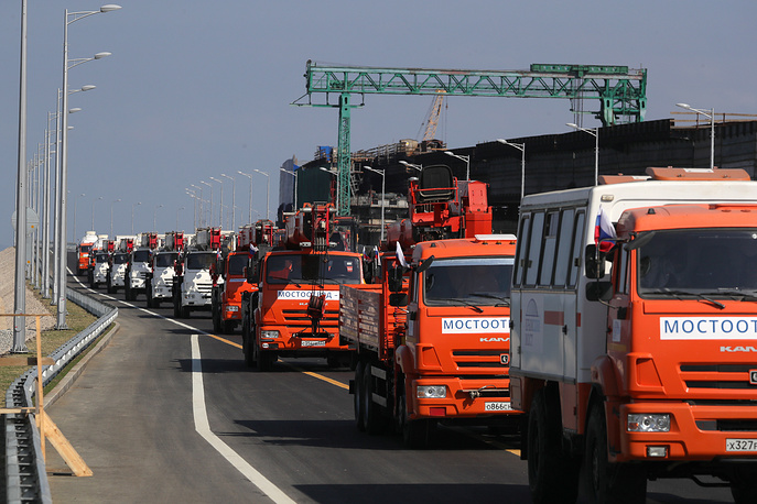 A convoy of construction machines passing through the Kerch Strait Bridge
