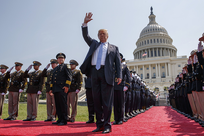 US President Donald Trump waves as he arrives for the 37th annual National Peace Officers Memorial Service on Capitol Hill, Washington, May 15