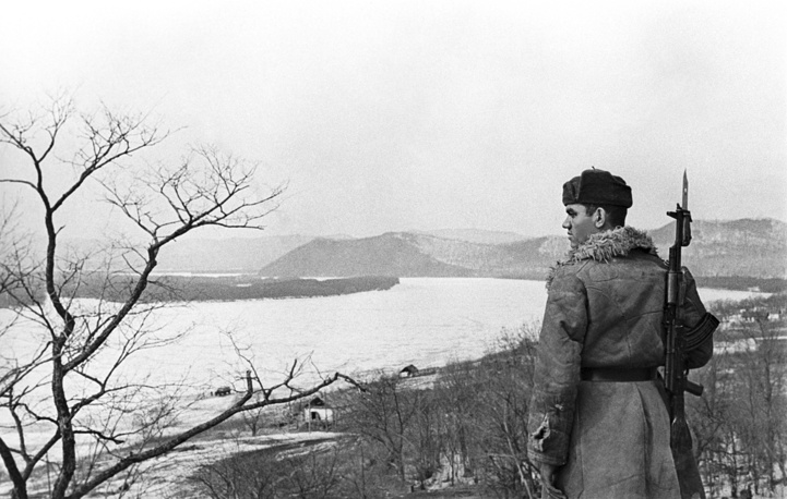 A Soviet border guard on the bank of the Ussuri river near Damansky island, 1969