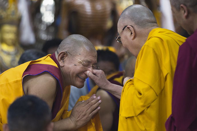Tibetan spiritual leader the Dalai Lama playfully pinches the nose of a senior monk as he arrives to give a talk to Tibetan youth in Dharmsala, June 7