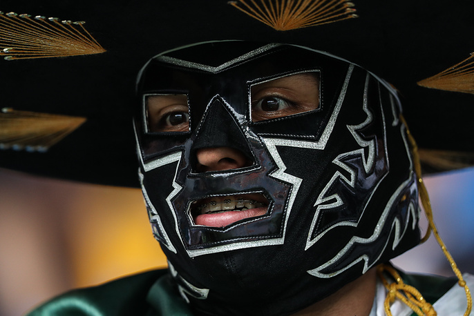 Mexico's supporter wearing a mask at Rostov Arena Stadium
