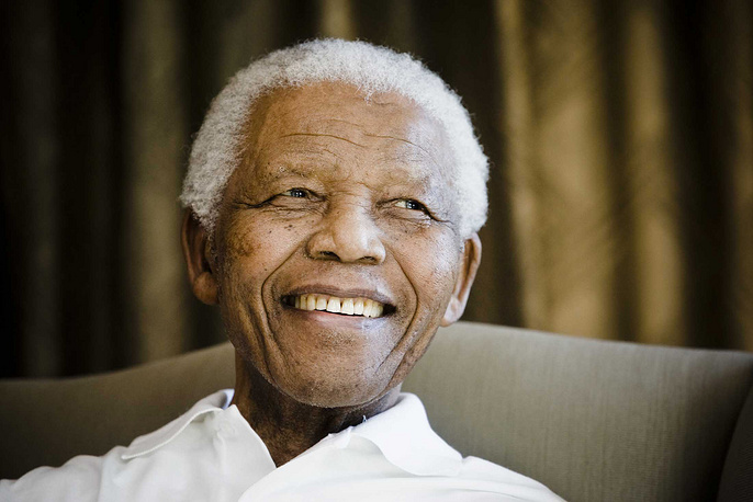 Former South African President Nelson Mandela reacts at the Mandela foundation, in Johannesburg, South Africa, 2009, during a meeting with a group of American and South African students as part of a series of activities leading to Mandela Day on July 18th