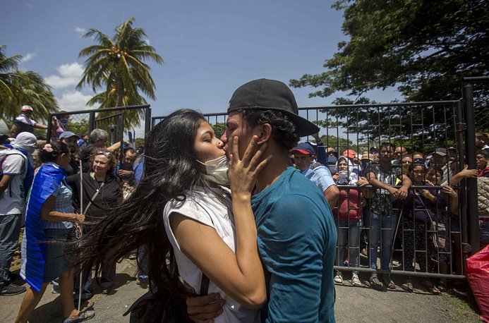 Two students kiss after leaving the shelter in the Divine Misericordia parish, in Managua, July 14. At least two people were killed and two were wounded after an armed attack perpetrated by paramilitary groups and police against university students protesters who were seeking shelter in the church, informed the Nicaraguan Cardinal Leopoldo Jose Brenes