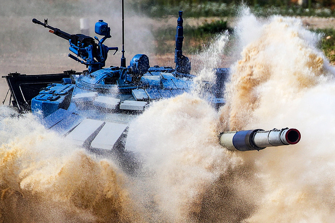 T-72B3 tank navigates a water obstacle in an individual race