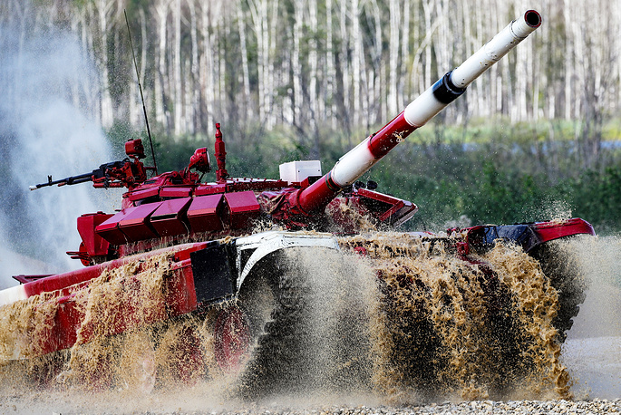 T-72B3 tank navigates a water obstacle in an individual race in Stage 1 of the Tank Biathlon Contest at the 2018 International Army Games in Alabino, Moscow region