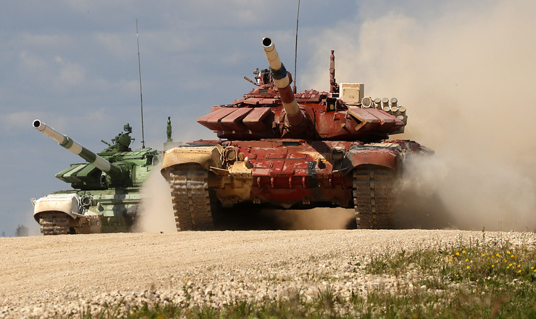 Soldiers from Mongolia and Armenia on a T-72 B3 tanks take part in the Tank biathlon competition