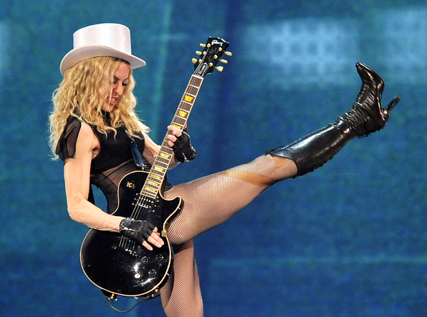 """Madonna performing during her concert of the """"Sticky and Sweet"""" world tour at the LTU-Arena in Duesseldorf, 2008"""